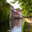 Classic view of channels of Bruges. Belgium. - Stock Photo