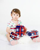 The little girl with gifts — Stock Photo