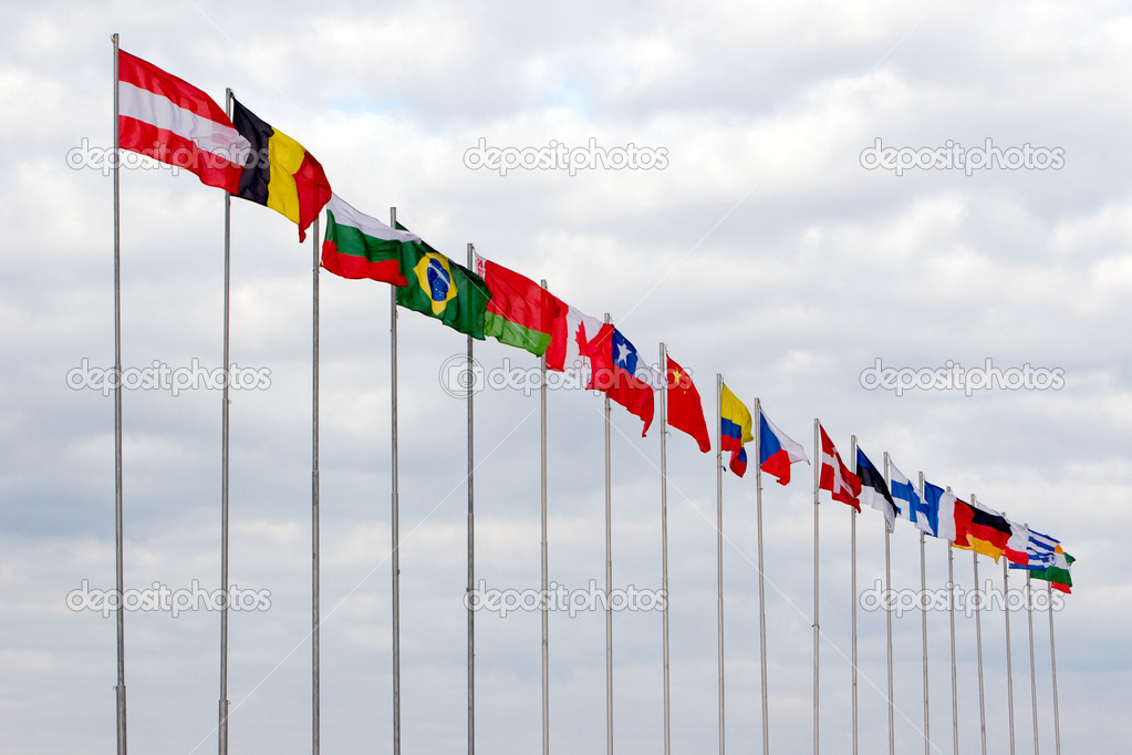 Flags of the different countries of the world fluttering on a wind — Stock Photo #11463239