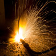 Sparks of the fused metal - Stock Photo