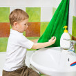 Boy wipes hands a terry towel after washing — Stock Photo #12333215