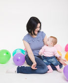 Mum plays with the eight-monthly daughter. — Stock Photo