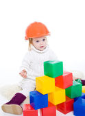 Baby girl plays with toy blocks — Stock Photo