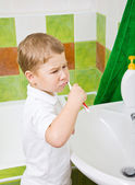 The boy brushes teeth. — Stock Photo