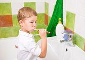 The boy brushes teeth. — Stock Photo
