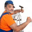 Handyman with  hammer  climbing ladder — Stock Photo