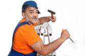 Handyman with hammer climbing ladder — Stock Photo