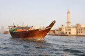 The bows of traditional wooden trading dhows moored in Dubai Creek, UAE. — Stockfoto