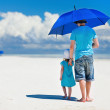 Father and daughter walking at beach — Stock Photo #10945410