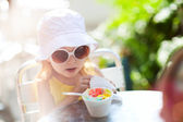 Cute girl eating ice cream — Stock Photo