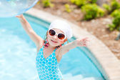 Adorable little girl at swimming pool — Stock Photo