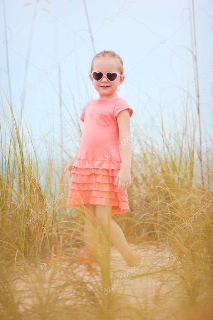 Sweet little girl outdoors in a high grass — Stock Photo #11080160