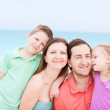 Happy family at tropical beach — Stock Photo #11192623