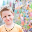 Cute boy at crafts market — Stock Photo #11192778