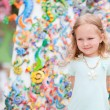 Little girl at crafts market — Stock Photo #11192827