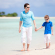 Father and son at beach — Stock Photo #11276515