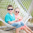 Kids relaxing in hammock — Stock Photo #11276776