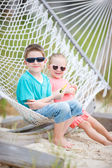 Kids relaxing in hammock — Stock Photo