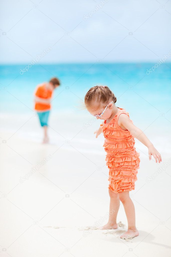 Sister and brother at tropical beach  Stock Photo #11277339