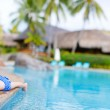 Little girl at swimming pool — Stock Photo #12208774