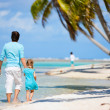 Father and daughter on a beach — Stock Photo #12209257