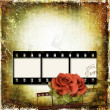 Grunge background with film frame and roses — Stock Photo