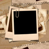 Vintage background with polaroid frame — Stock Photo