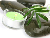 Green leaf and candles — Stock Photo