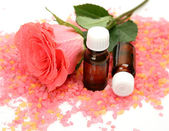 Pink rose and aromatic oil — Stock Photo