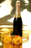 Champagne and yellow roses — Stock Photo
