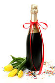Champagne and tulips — Stock Photo
