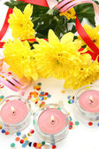 Fine flowers and candles — Stock Photo