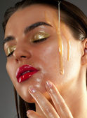 Beauty treatment with olive oil — Stock Photo