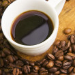 Stock Photo: Cup of coffee and beans