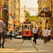 Vintage tram on the Taksim Istiklal Street - Stock Photo