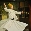 ISTANBUL, TURKEY - June 03: Whirling dervish dancing in Café Meşale on June 03, 2012 in Istanbul, Turkey. Sufi whirling is a form of Sama or physically active meditation practiced by Sufi Dervishes. — ストック写真