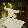 ISTANBUL, TURKEY - June 03: Whirling dervish dancing in Café Meşale on June 03, 2012 in Istanbul, Turkey. Sufi whirling is a form of Sama or physically active meditation practiced by Sufi Dervishes. — Stock Photo