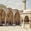 Tourists in courtyard of Sultanahmet Mosque — Stock Photo #11274983