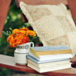 Books, and marigolds in a vase stock image — Stock Photo