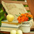 Royalty-Free Stock Photo: Books, fresh apples, and marigolds in a vase stock image