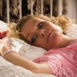Sexual blonde lying on a bed — Stock Photo