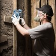 Stock Photo: Builder in respirator and goggles