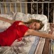 Stock Photo: Sexual blonde in red sleeping