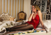 Sexual blonde sitting on the bed — Стоковое фото