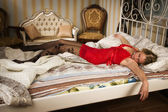 Sexual blonde in red sleeping — Stock fotografie