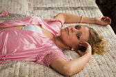 Attractive blonde lying on the bed — Stock Photo