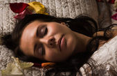 Sexual brunette sleeping on a bed — Stock Photo