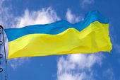 Ukrainian flag waving on cloudy sky — Stock Photo