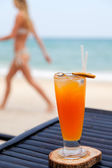 Orange juice in glass with ice, straw and fruit slice — Stock Photo