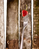 Strawberry on fork — Stock Photo